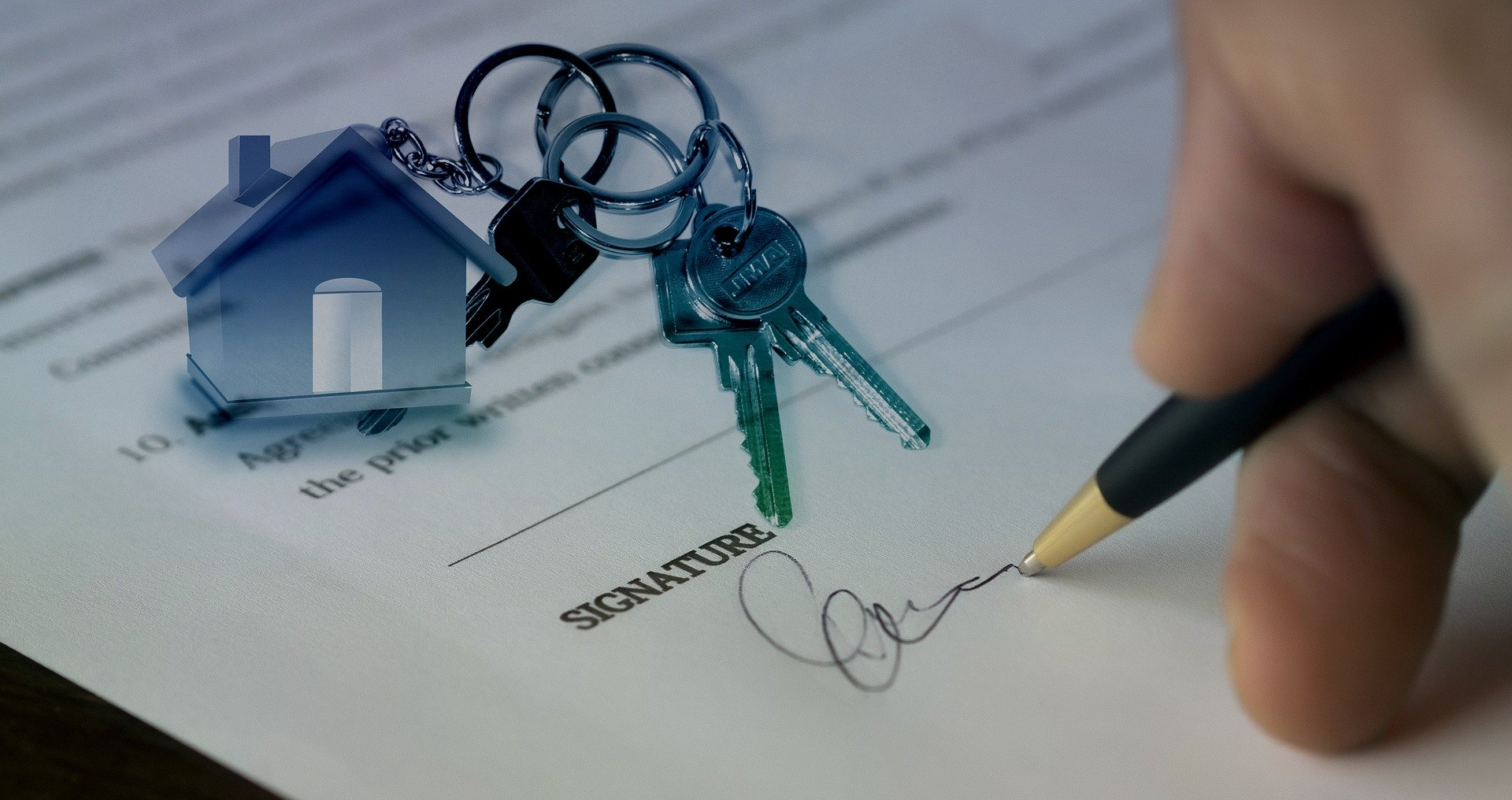 Someone signing for a house